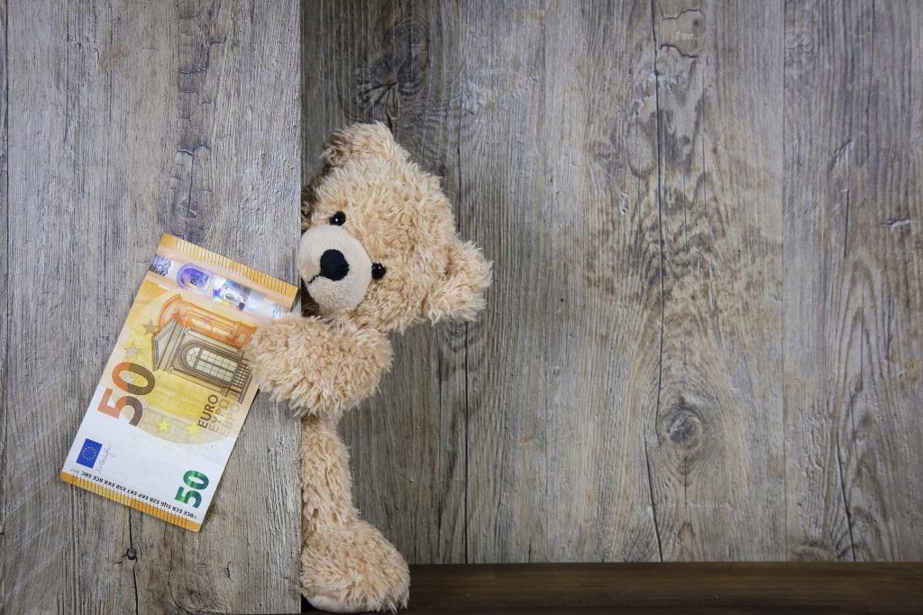teddy-bear-holding-money