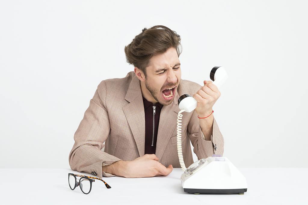 man yelling at phone angrily